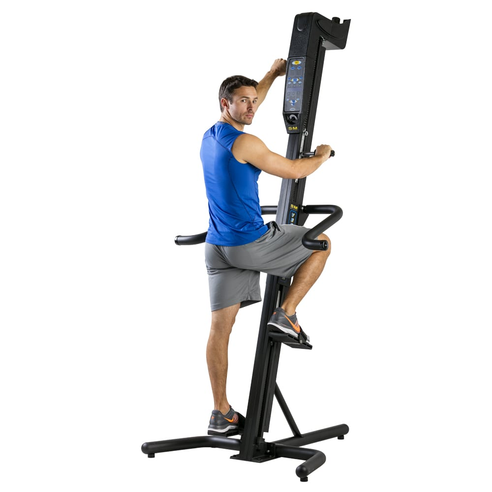 Man using the SM Sport Model Versaclimber Vertical Climbing Machine