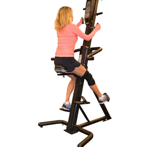 Woman using the VersaClimber Adjustable Seat Accessory