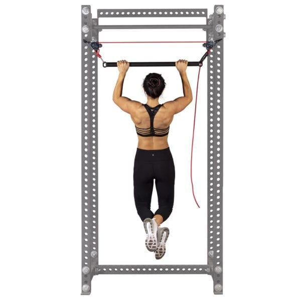 Woman doing pull ups on the VRX